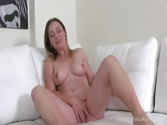Impressive big-breasted cutie is shoving fingers in her snatch
