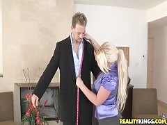 Clothed blonde sucking her customer in CFNM Secret video