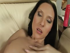 Black haired red dildos fucks herself