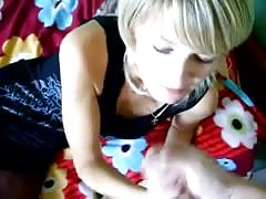 Bleached cutie is licking and sucking a dick without using her hands
