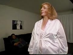 Mature lady is blowing a big black dick in the close-up