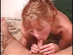 Tanned blonde is taking his hard dick deep in her mouth