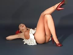 Elegant long-legged casting girl is posing in the sexy red high heels