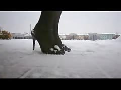 Nylon legs and high heels in snow